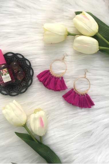 Golden circle earrings and pompons